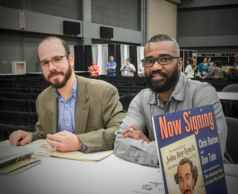Chris Barton and I sign THE AMAZING AGE OF JOHN ROY LYNCH at the Texas Library Association conference